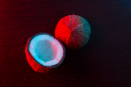 coconut in red and blue light. dark background