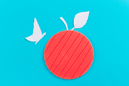 butterfly on an apple. made of paper