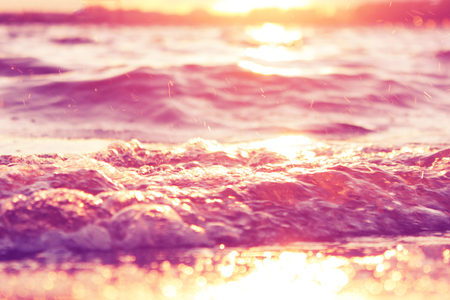 Abstract pink water background. sunset over the sea