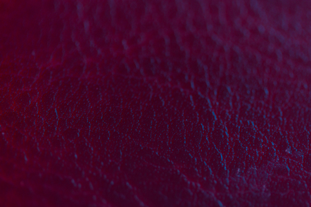 Dark pink leather texture background surface. neon light