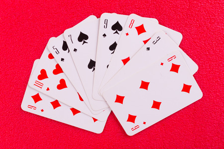 Playing cards near wineglass of whiskey and cigar. paper cut