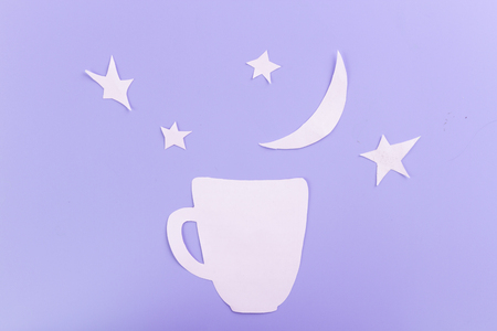 cup on starry sky background made of paper