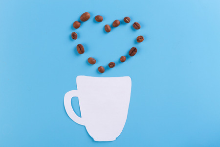 heart and coffee cup on blue background