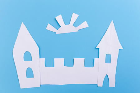castle made of paper on blue background