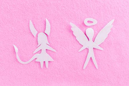 devil woman and angel man on pink background