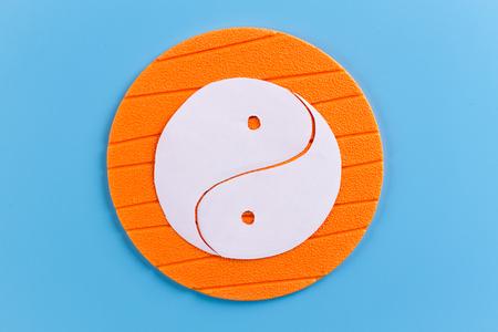 Yin Yang Symbol on orange background. cartoon style Stock fotó