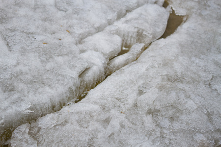 cracked ice on river in spring. danger concept 스톡 콘텐츠 - 124600607
