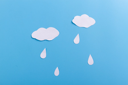 rain clouds on the blue background. minimal Stock Photo