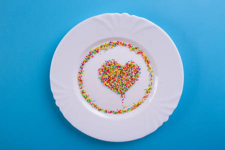 colorful confectionary dressing in a shape of heart