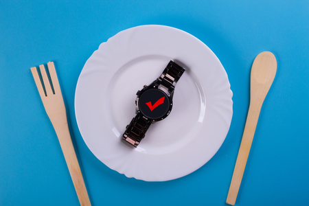 Top view clock in a dish. time to eat Stock Photo