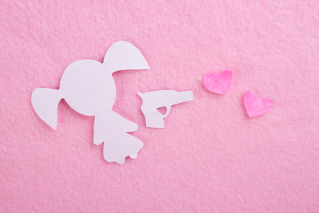 girl with gun and hearts. love concept