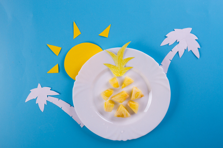 pineapple slices on the blue background. summer fruits