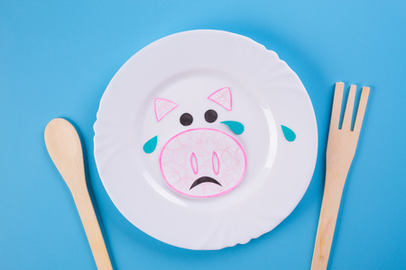 Vegan motivational illustration. crying animals on the plate Фото со стока