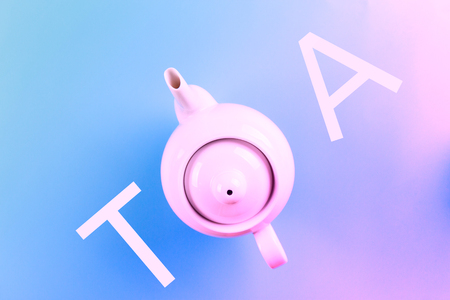 Directly above view of teapot on blue background Фото со стока