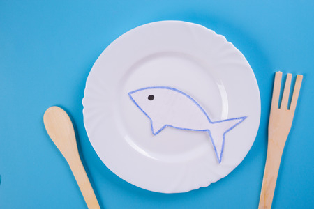 fish in the plate. cartoon styled
