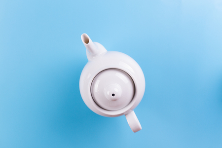 Directly above view of teapot on blue background 写真素材