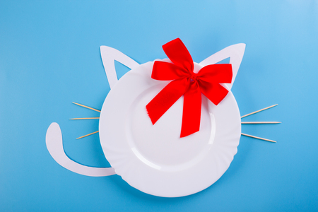 lovely plate for a cat with ears and bow Stock Photo