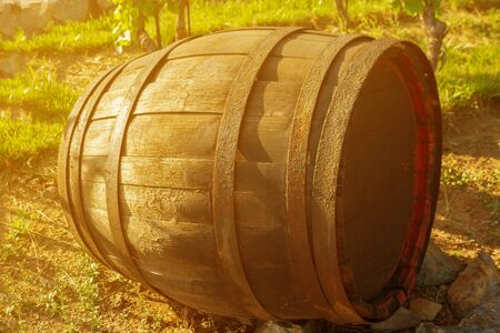 single wooden cask with wine laying on the ground