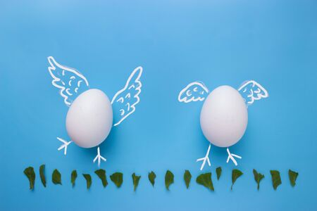 Eggs on blue background with copy space