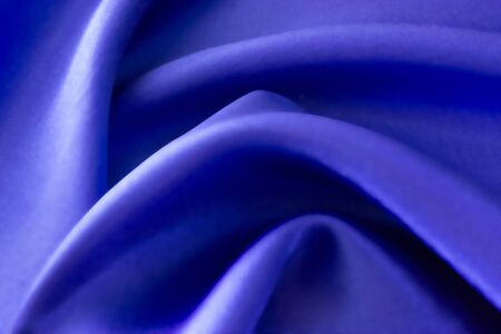 Silk material background. Blurred background. Cloth. Fabric Imagens