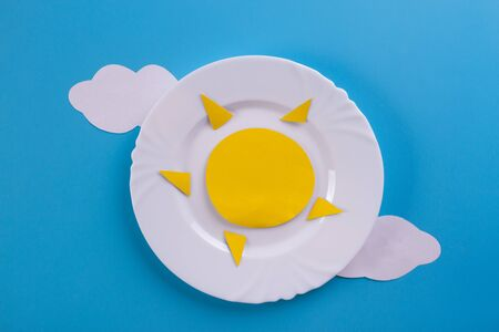 sun on the plate. summer concept