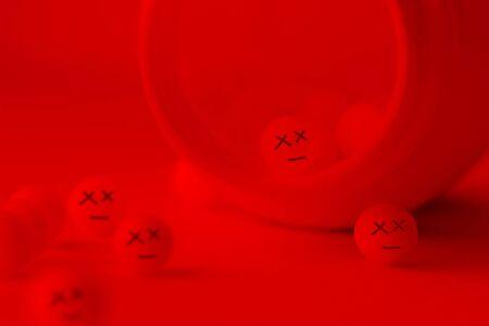Pills with dead faces. poisonous pills concept