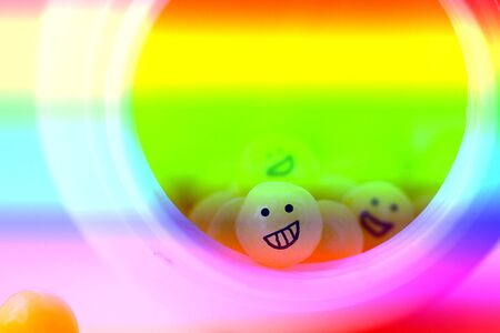 Extasy pills with crasy smiles. Colorful toned image Imagens