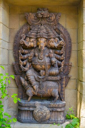 Bronze colored statue of indian god Ganesh Stock Photo