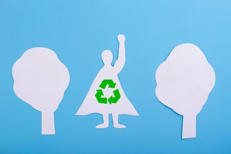 Recycle superhero concept illustration. Made of paper