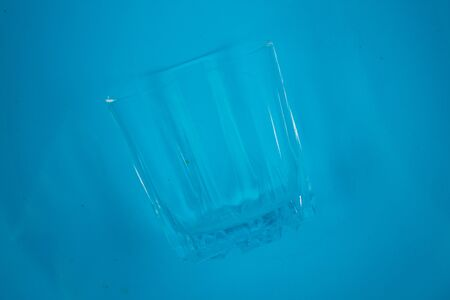 water in a glass on blue background