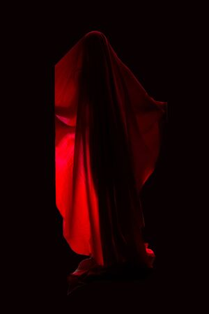 Scary person in red dress over black background