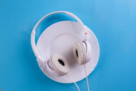 white headphones on the blue background. Flat lay Archivio Fotografico