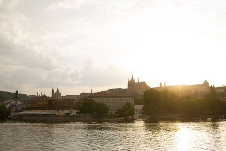 View over Prague city on the sunset. St. Vita Cafedral 写真素材