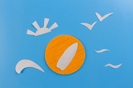 Summer concept image. Paper art of sea and sun
