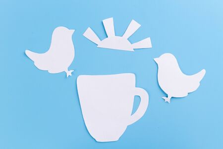 Early morning concept. Bird singing on tea cup