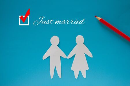 Just married couple. Paper couple on blue background