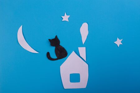 Paper art of black cat on the roof