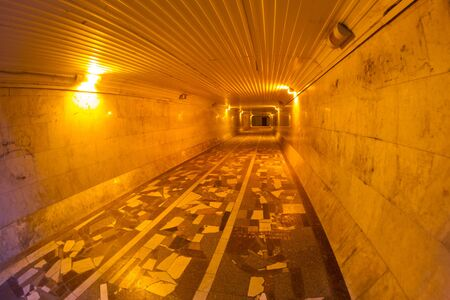 Tunnel yellow light bulbs. Pedestrian tunnel underground