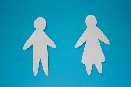 Paper couple on blue background. Love concept