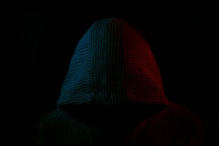 Portrait of Invisible man in the hood on black background Stockfoto