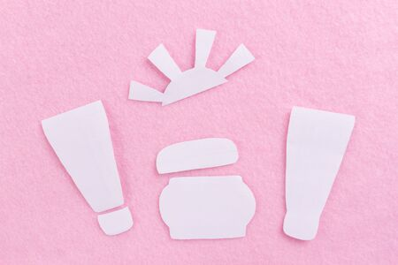 Concept of different sun care products. Pink background