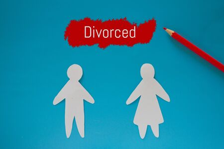 Divorced couple concept image. Paper couple and divorced sign