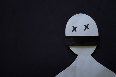 Paper person with shuted mouth. Violence concept Stockfoto