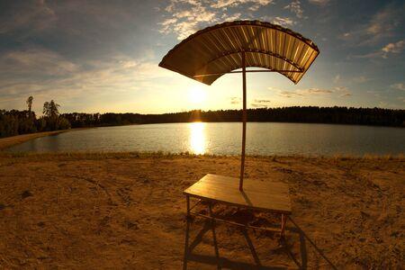 Umbrella next to lake. relax by lake 스톡 콘텐츠