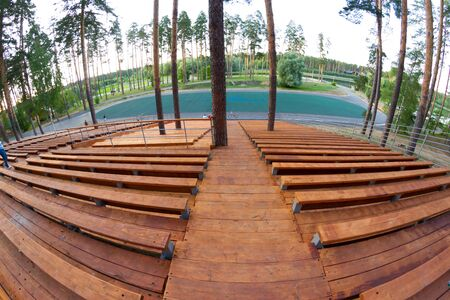 Wooden staduim in forest. Big staduim in park Stock Photo