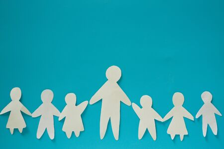 Father of many children concept. Paper cut Stock Photo