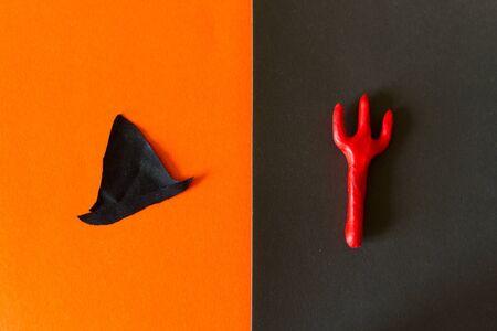 Different hallooween decorations made from paper. Orange background Zdjęcie Seryjne