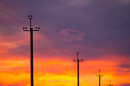 High voltage line over sunset background