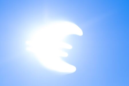 Euro symbol on sky background instead of the sun Archivio Fotografico