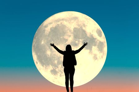 Silhouette of a woman. Full moon background